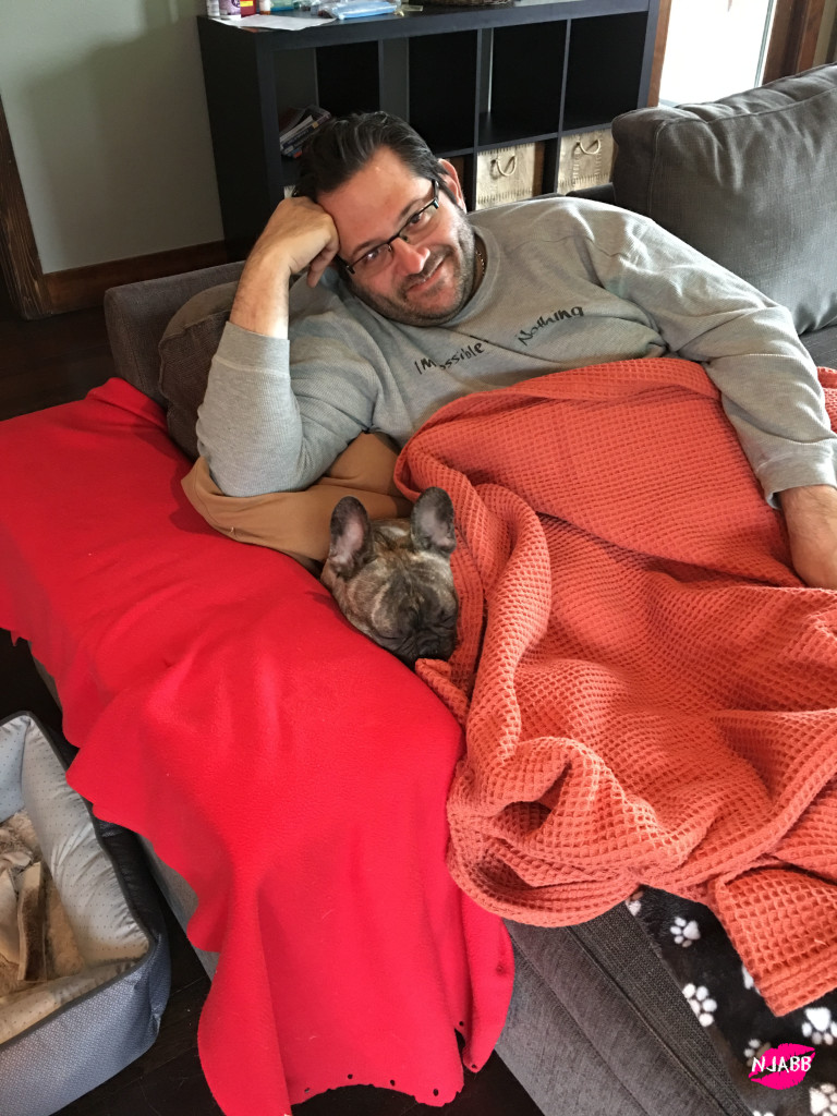 Baby Frenchie and darling husband staying warm.
